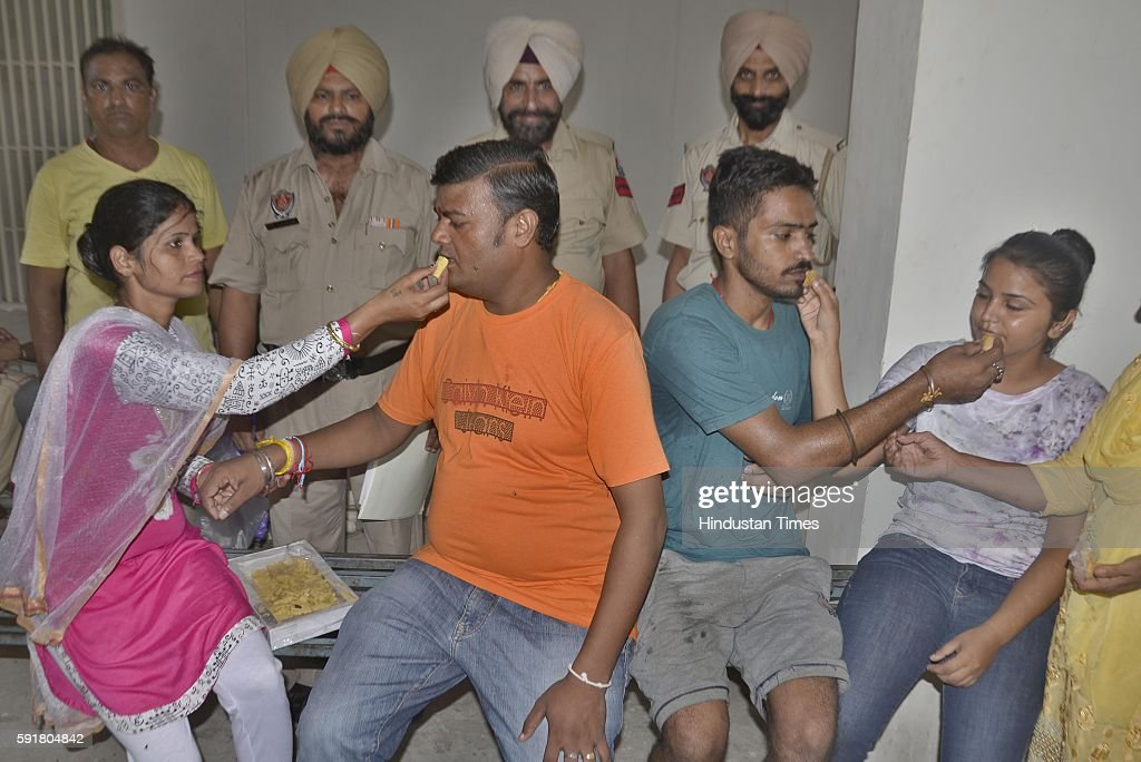 Girls and women tying rakhi to their brothers on the auspicious occasion of Raksha Bandhan at Fatehpur on August 18 2016 in Amritsar India On the...