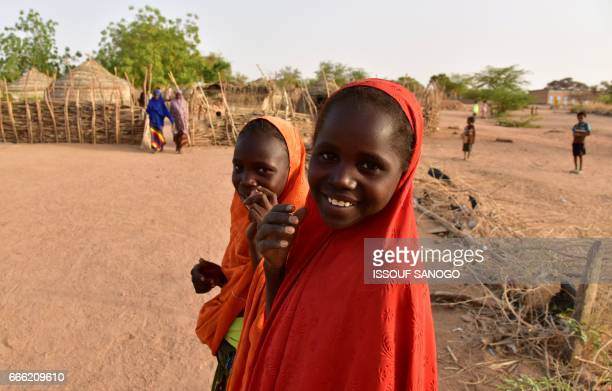 Girls are pictured in the village of Azel near Agadez northern Niger on April 6 2017 The region has been recently hit by severe drought / AFP PHOTO /...