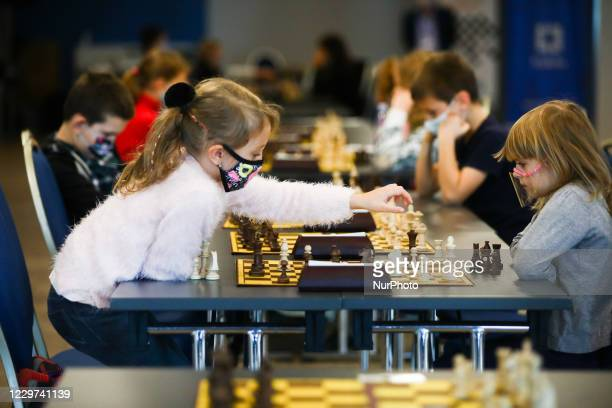Girls are playing chess during coronavirus pandemic at Junior Speed Chess Championship in Krakow, Poland on November 21, 2020.