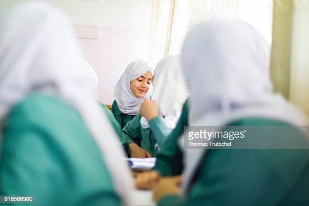 Girls are sitting on school benches during lesson in the Ajnadayn girls school on October 05 2016 in Irbid Jordan