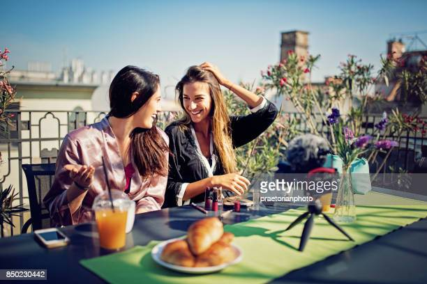 girls are vlogging about make up on the roof terrace in the morning - very young webcam girls stock photos and pictures