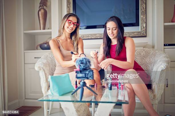 girls are vlogging about make up - little girls webcam stock photos and pictures