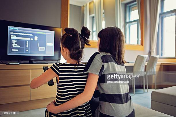 girls are watching tv - data stream stock photos and pictures
