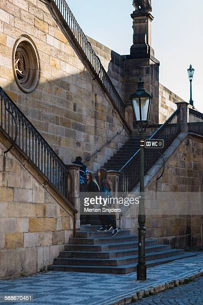 girls ascending stairs of charles bridge - merten snijders stock pictures, royalty-free photos & images
