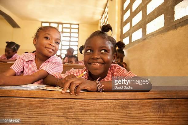 girls at desk in school  - haiti stock-fotos und bilder
