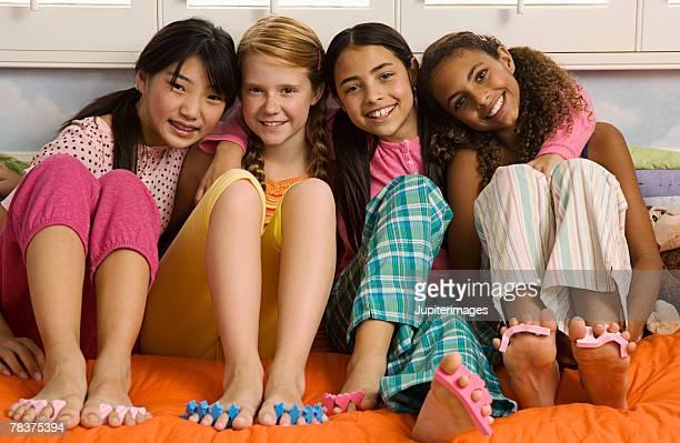 girls at slumber party - black pedicure fotografías e imágenes de stock