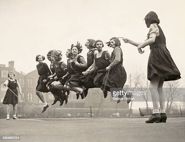 Girls at the Archbishop Tenison school in Lambeth London jump rope on the playground during recess