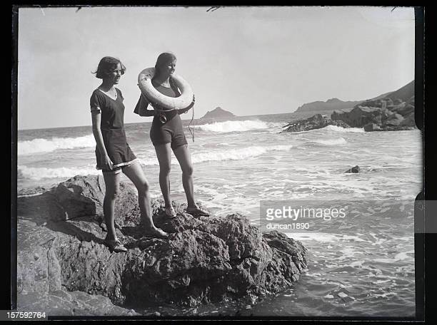 girls at the seaside - vintage photograph - history stock pictures, royalty-free photos & images