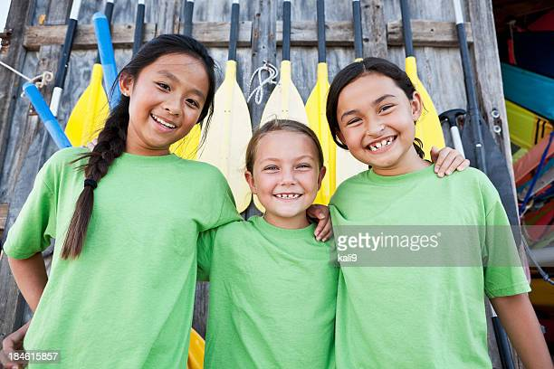 girls at water sports equipment center - tee sports equipment stock photos and pictures