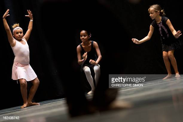 Girls attend a classic dance class given by teachers from the Royal Opera House to children from Brazilian dance schools and from shantytowns at the...