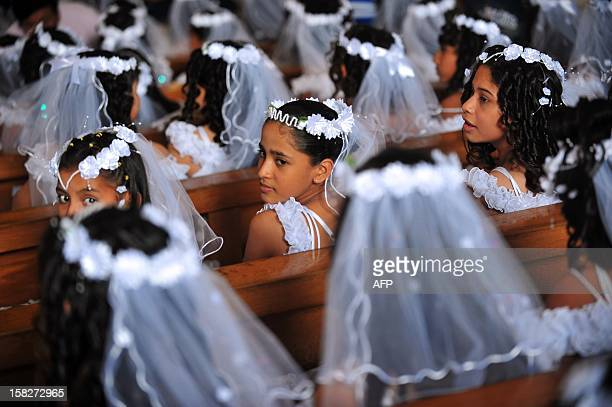Girls attend a mass in which about 550 children had their first communion at the metropolitan cathedral in Managua on December 12 2012 AFP...