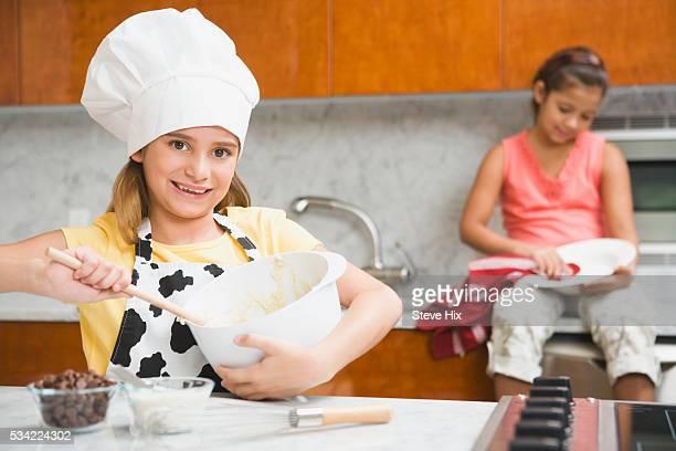 girls baking - female whipping stock-fotos und bilder