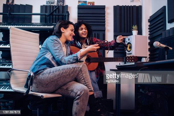 girls band working on a new record in the studio - singer songwriter stock pictures, royalty-free photos & images