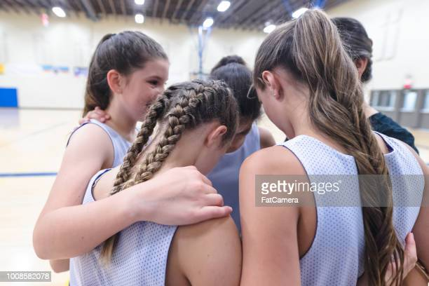 girls basketball coach leads a pre-game huddle - basketball sport stock pictures, royalty-free photos & images