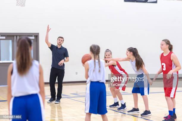 girls basketball team practicing - sports training camp stock pictures, royalty-free photos & images