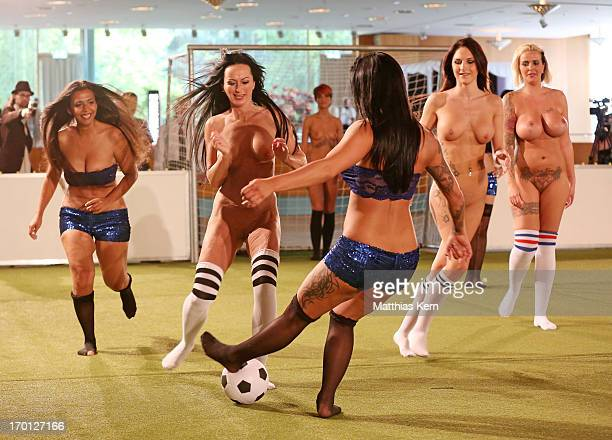 Girls battle for the ball during the first women's naked soccer European Championship at 'Palais am Funkturm' on June 7, 2013 in Berlin, Germany.