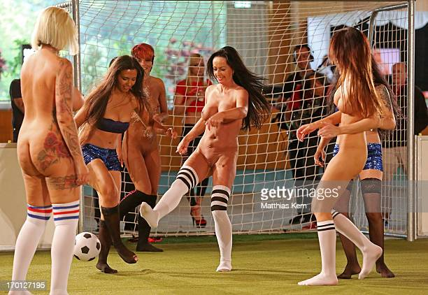Girls battle for the ball during the first women's naked soccer European Championship at 'Palais am Funkturm' on June 7 2013 in Berlin Germany