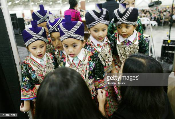 Girls belonging to the group Nkauj Hmoob America Friendship of Milwaukee wear their traditional Hmong outfits as they prepare to dance as part of the...