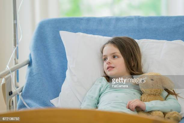 girl's best friend - girl in hospital bed sick stock photos and pictures