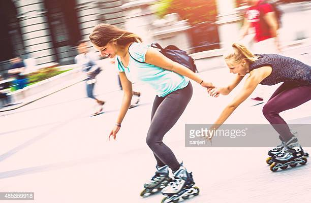 Girls bonding together and having fun with rollerskates