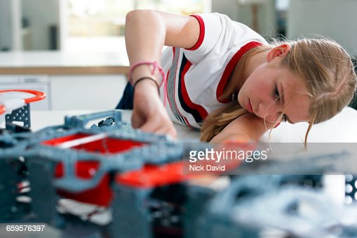 Girls building a robot