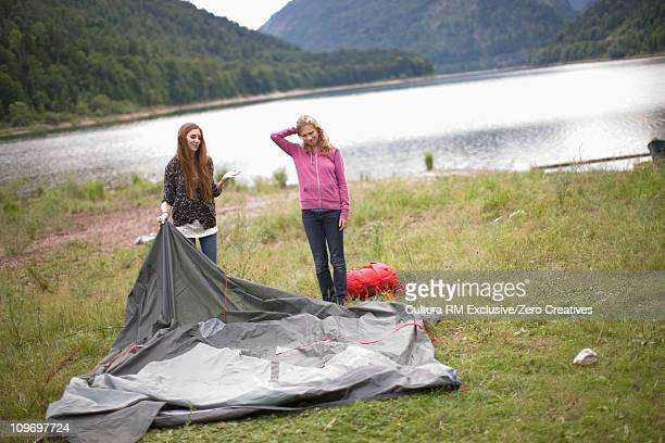Girls building up a tent