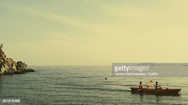Girls canoeing in sea