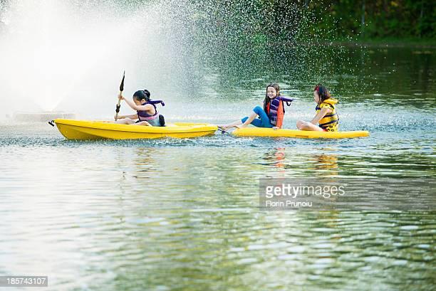 Girls canoeing on lake