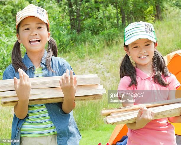 Girls Carrying Firewood