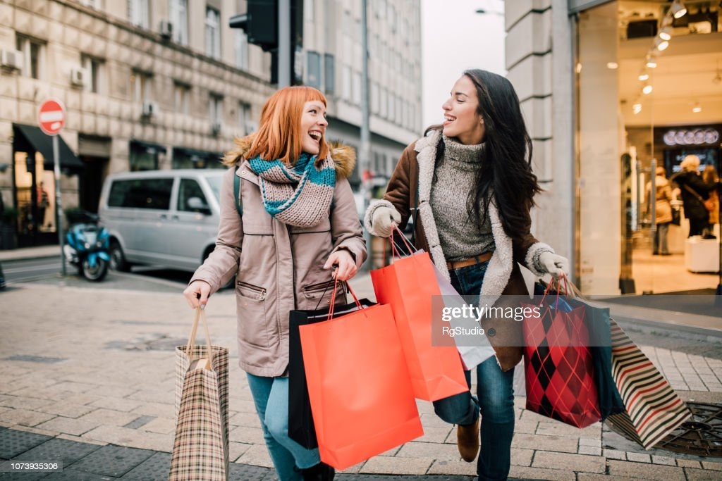 Girls carrying shopping bags : Stock Photo