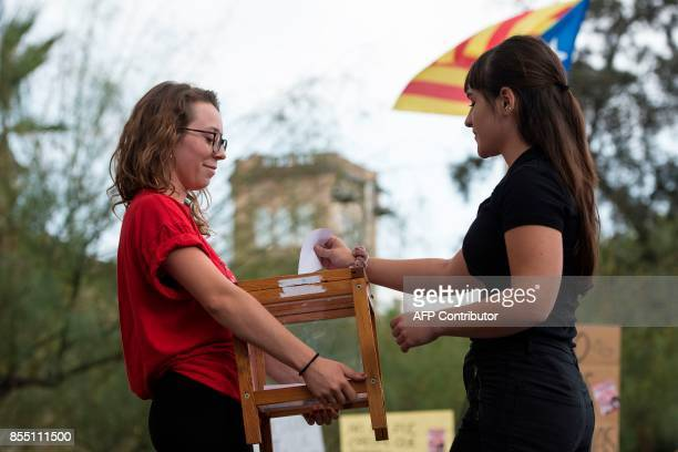 A girls casts a symbolic ballot in a box during a proreferendum demonstration called by students on September 28 2017 in Barcelona Thousands of...