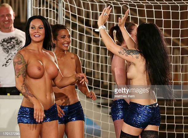 Girls celebrate a goal during the first women's naked soccer European Championship at 'Palais am Funkturm' on June 7 2013 in Berlin Germany