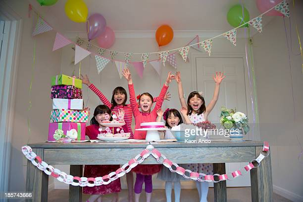 girls cheering at birthday party - cobham surrey stock pictures, royalty-free photos & images