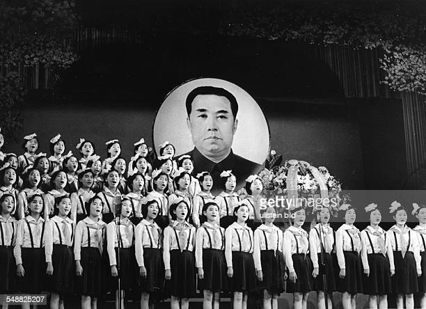 A girls' choir sings in front of a huge portrait of 'Great Leader' Kim Il Sung in the Palace of Culture in Pyongyang