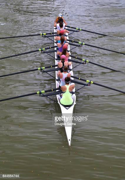 Girls club Team Rowing in a Racing Shell