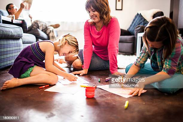 girls coloring with mother