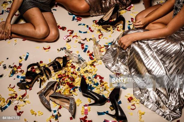 girls, confetti, shoes and bottles on the floor after party - after party stock pictures, royalty-free photos & images