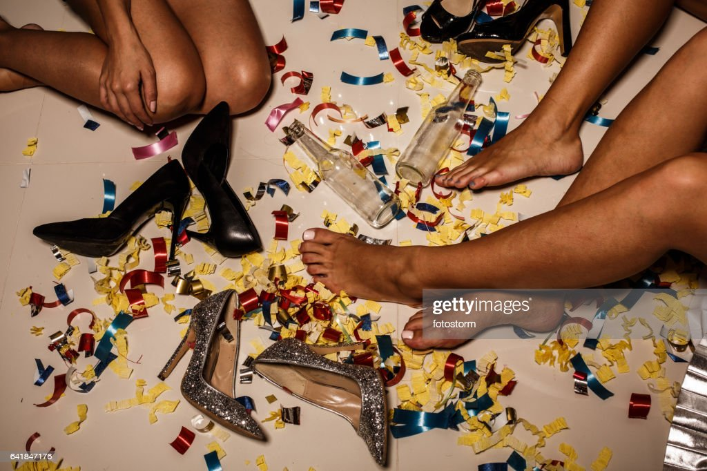 Girls, confetti, shoes and bottles on the floor after party : Stock Photo