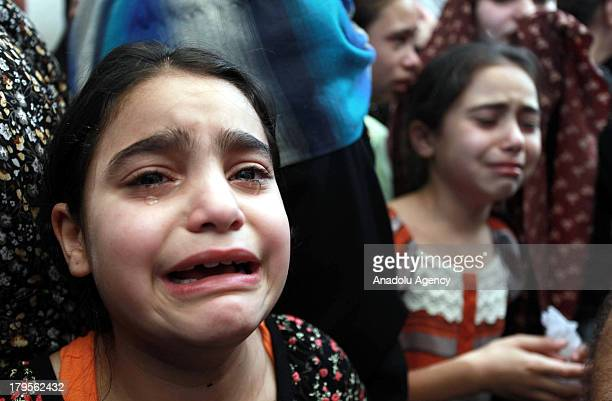 A girls cries at the funeral of three Palestinians on August 262013 at the Qalandia Refugee Camp near Ramallah Palestine The 3 Palestinians died...
