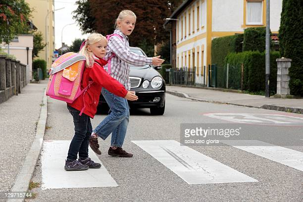 Girls crossing street on way to school