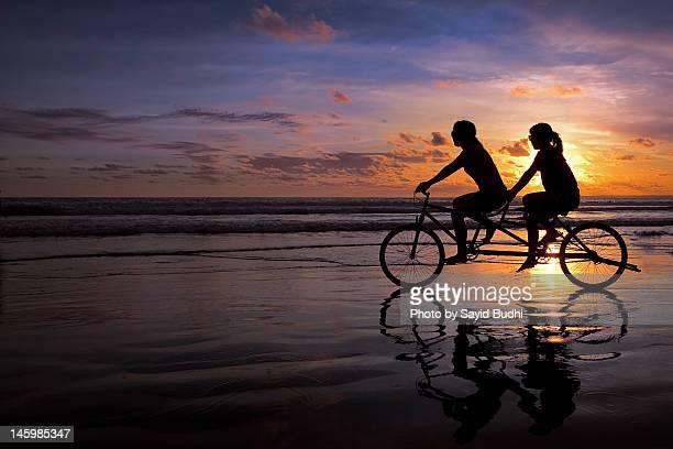 Girls cycling at seaside