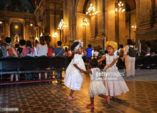 Girls dance during a mass celebration on the first anniversary of Brazilian councilwoman Marielle Franco's death in Rio de Janeiro Brazil on March 14...