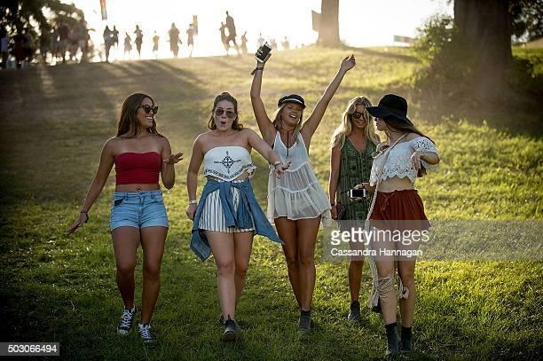 Girls dance in a field at Falls Festival on January 1 2016 in Byron Bay Australia