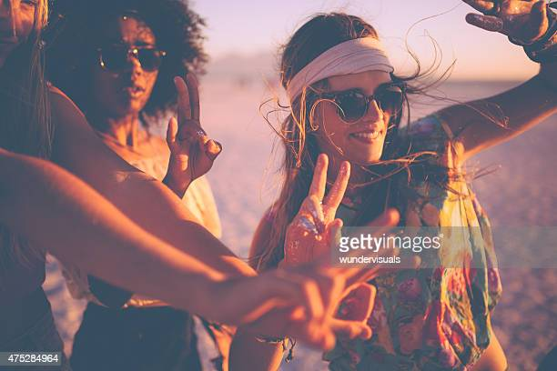girls dancing at a beachparty at sunset - hippie woman stock photos and pictures