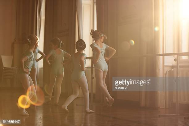 Girls dancing ballet in beautiful sunlight
