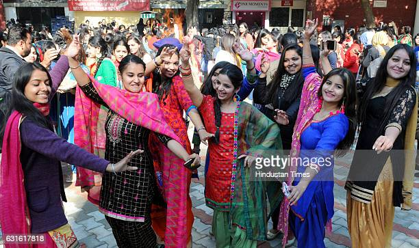 Girls dancing during Lohri celebration at MCM College, Sector 36 on January 13, 2017 in Chandigarh, India. It is one of the most popularly celebrated...