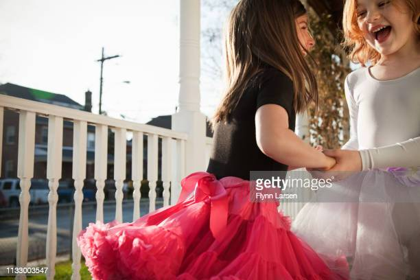 girls dancing in ballet costumes on porch - pink dress stock pictures, royalty-free photos & images