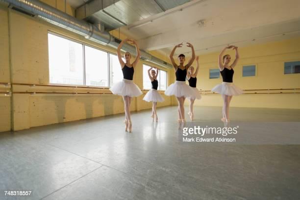 girls dancing in ballet studio - ballettstudio stock-fotos und bilder