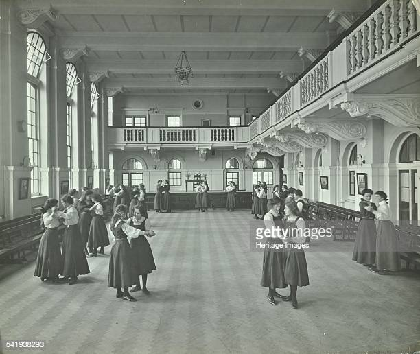 Girls dancing in the assembly hall Clapham Secondary School London 1910 Artist unknown