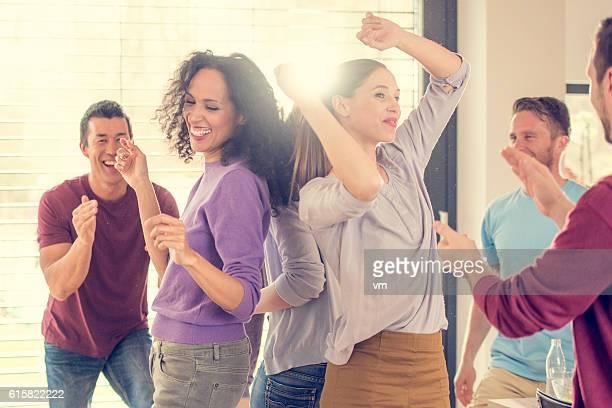 Girls dancing, men clapping